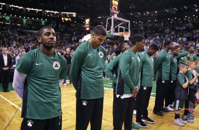 <p>Boston Celtics guard Kyrie Irving, left, and his teammates pause for a moment of silence for victims of the Las Vegas concert shooting, prior to the team's NBA preseason basketball game against the Charlotte Hornets in Boston, Monday, Oct. 2, 2017. (Photo: Charles Krupa/AP) </p>