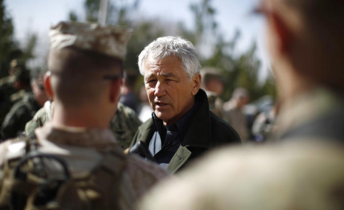 U.S. Secretary of Defense Chuck Hagel, center, talks with members of the U.S. Army and Marines during his visit to the Kabul Military Training Center in Kabul, Afghanistan, Sunday, March 10, 2013. Hagel is on his first trip to Afghanistan as defense secretary. (AP Photo/Jason Reed, Pool)