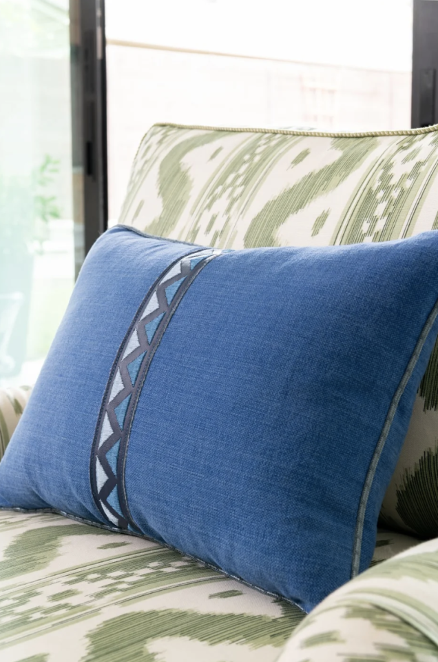 "<p>""We use it to make a pillow feel finished,"" says designer Kristen Nix. Here, a simple stripe of trim down the center of a solid pillow adds a dash of pattern. </p>"