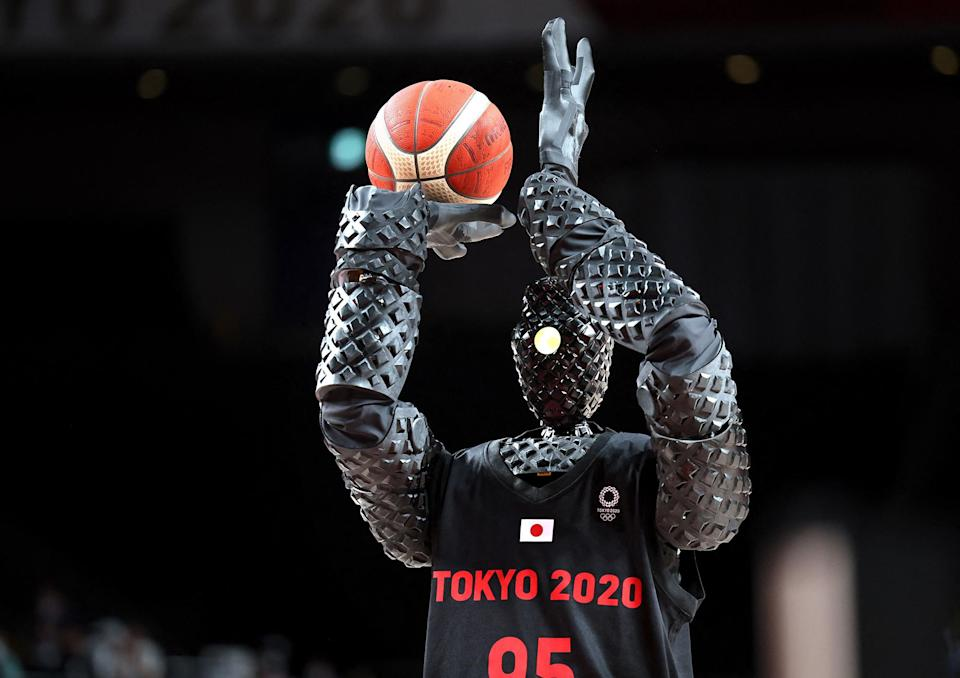 <p>A basketball-playing robot named CUE plays during halftime of the men's preliminary round group B game between the United States and France on July 25.</p>