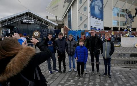 Leeds fans pose for pictures outside Elland Road - Credit: pa