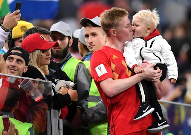 <p>Kevin De Bruyne of Belgium celebrates with his son following his sides victory in the 2018 FIFA World Cup Russia Semi Final match between Belgium and France at Saint Petersburg Stadium on July 10, 2018 in Saint Petersburg, Russia. (Photo by Laurence Griffiths/Getty Images) </p>