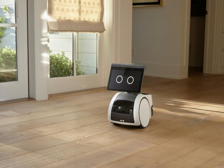 """This handout image courtesy of Amazon.com, Inc. shows the camera-equipped home robot """"Astro"""" patrolling a house (AFP/-)"""