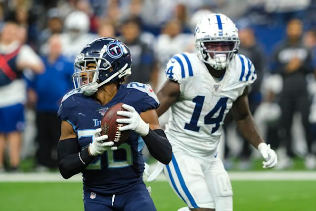 Tennessee Titans cornerback Logan Ryan (26) intercepts a pass intended for Indianapolis Colts wide receiver Zach Pascal (14) during the second half of an NFL football game in Indianapolis, Sunday, Dec. 1, 2019. (AP Photo/AJ Mast)