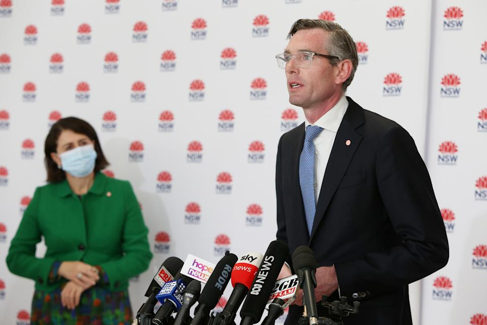 NSW Treasurer Dominic Perrottet speaks as NSW Premier Gladys Berejiklian looks on during a COVID-19 update and news conference on July 28, 2021 in Sydney, Australia