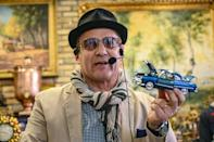 Laser pens, toy cars, furniture -- auctioneer Ali Tuna has plenty to show bidders who he entices in with friendly banter