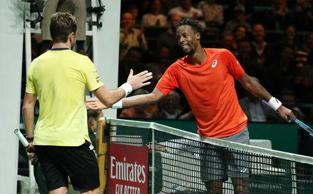 Friendly fire as Monfils beats Wawrinka to win Rotterdam Open
