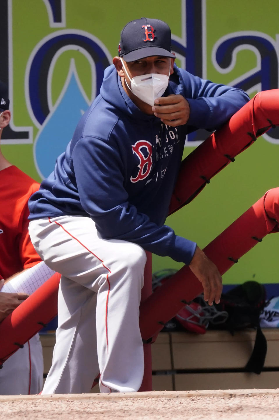 Boston Red Sox manger Alex Cora watches from the dugout as his team plays the Atlanta Braves in a spring training baseball game on Tuesday, March 23, 2021, in North Port, Fla. (AP Photo/John Bazemore)
