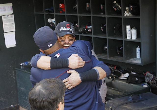 Cleveland Indians' Nick Swisher hugs a teammate in the dugout after the Indians beat the Twins 5-1 to clinch a wild card spot in the playoffs in a baseball game in Minneapolis, Sunday, Sept. 29, 2013. (AP Photo/Ann Heisenfelt)