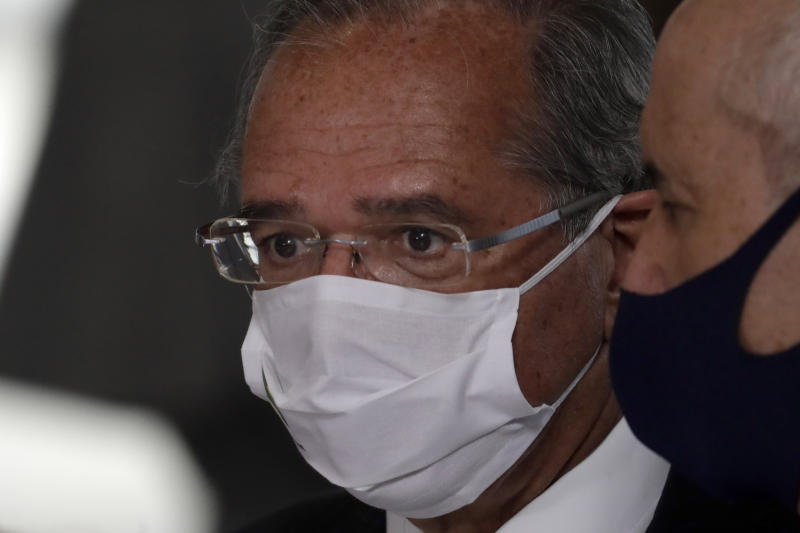 Brazil's Economy Minister Paulo Guedes arrives for a ceremony celebrating National Volunteer Day, at Planalto presidential palace in Brasilia, Brazil, Friday, Aug . 28, 2020. (AP Photo/Eraldo Peres)