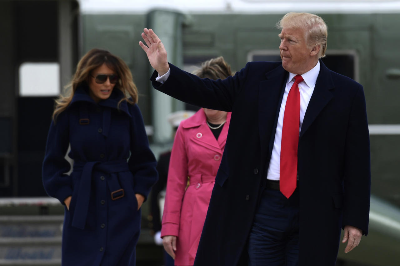 President Donald Trump and first lady Melania Trump walk from Marine One towards Air Force One at Andrews Air Force Base, Md., Monday, March 19, 2018. Trump is traveling to New Hampshire to unveil more of his plan to combat the nation's opioid crisis. (AP Photo/Susan Walsh)