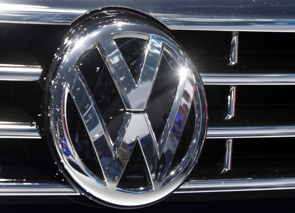 FILE - In this Sept. 22, 2015, file photo, the logo of Volkswagen at a car is photographed during the Car Show in Frankfurt, Germany. Luxury brands Audi and Porsche are fattening the bottom line at German automaker Volkswagen. The company's premium brands saw record sales in the first half of the year. That helped the Wolfsburg-based auto giant make more money than it did even before the pandemic. The company made 11.4 billion euros, or $13.5 billion, in the first half of the year.(AP Photo/Michael Probst, File)