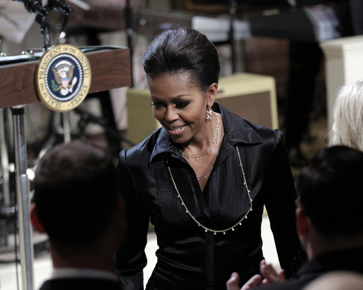 First lady Michelle Obama arrives for the White House Music Series saluting Motown in the East Room of the White House in Washington, Thursday, Feb. 24, 2011.