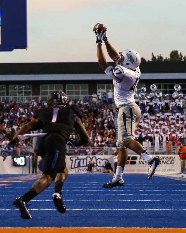 Nevada tight end Jarred Gipson (47) makes a catch in front of Boise State cornerback Bryan Douglas (1) during the first half of an NCAA college football game in Boise, Idaho, Saturday, Oct. 19, 2013. (AP Photo/Otto Kitsinger)