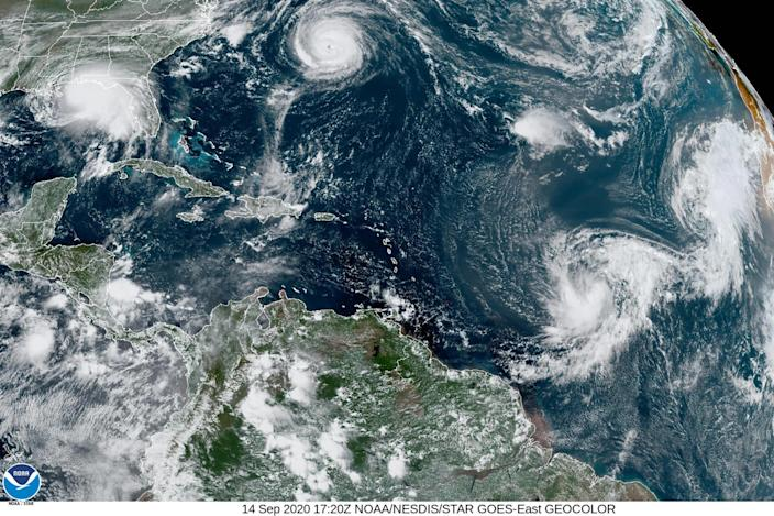 This satellite image provided by the NOAA shows five tropical cyclones churning in the Atlantic basin at 5:20 p.m. GMT on Monday, Sept. 14, 2020. The storms, from left, are Hurricane Sally over the Gulf of Mexico, Hurricane Paulette over Bermuda, the remnants of Tropical Storm Rene, and Tropical Storms Teddy and Vicky. / Credit: AP