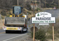 "Vehicles pass a sign welcoming people to Paradise, Calif., Tuesday Nov. 5, 2019. The sign also displays the slogan, ""Rebuilding The Ridge,"" that has become the community's rallying cry since a wildfire devastated the area a year earlier. (AP Photo/Rich Pedroncelli)"