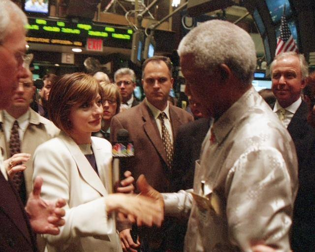 A file photo of Maria Bartiromo on the New York Stock Exchange floor with Nelson Mandela.