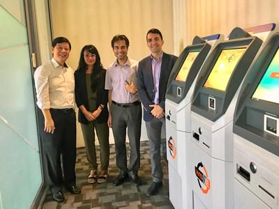 Jack Bai and Jelurida team members during their visit to Singapore in November 2018 with the Wise MPay ATMs (PRNewsfoto/Jelurida Swiss SA)