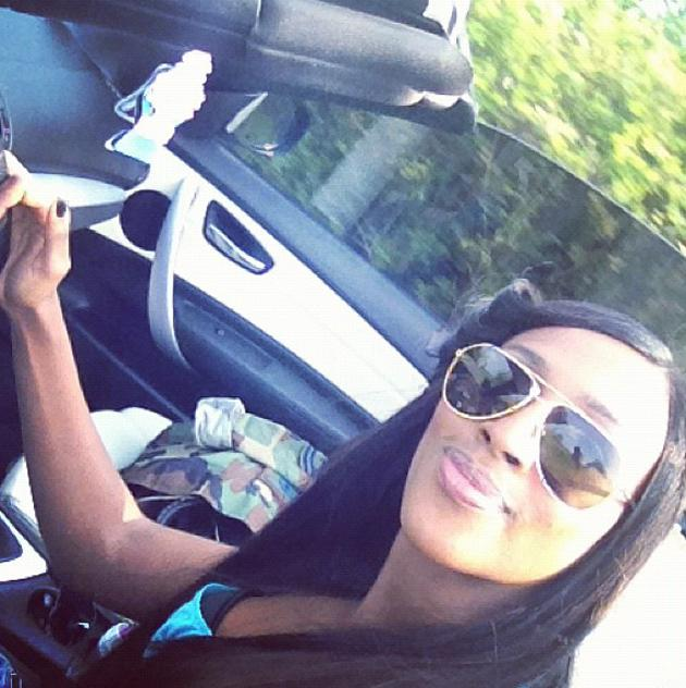 Celebrity photos: Alexandra Burke made the most of the hot weather this week by going for a drive with her roof down. Oh we are so envious.