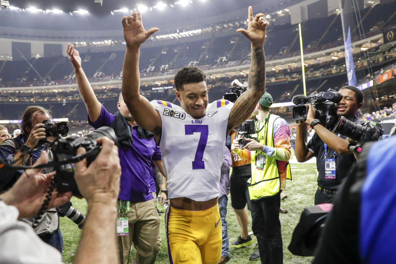 NEW ORLEANS, LA - JANUARY 13: Safety Grant Delpit #7 of the LSU Tigers raises his hands to the fans while he is leaving the field after the College Football Playoff National Championship game against the Clemson Tigers at the Mercedes-Benz Superdome on January 13, 2020 in New Orleans, Louisiana. LSU defeated Clemson 42 to 25. (Photo by Don Juan Moore/Getty Images)