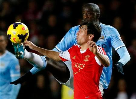 Manchester City's Yaya Toure challenges Southampton's Jack Cork (front) during their English Premier League soccer match at St Mary's stadium in Southampton, southern England December 7, 2013. REUTERS/Stefan Wermuth