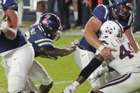 Mississippi running back Jerrion Ealy (9) follows his blockers as he rushes for an 8-yard touchdown during the second half of an NCAA college football game against Mississippi State, Saturday, Nov. 28, 2020, in Oxford, Miss. Mississippi won 31-24. (AP Photo/Rogelio V. Solis)