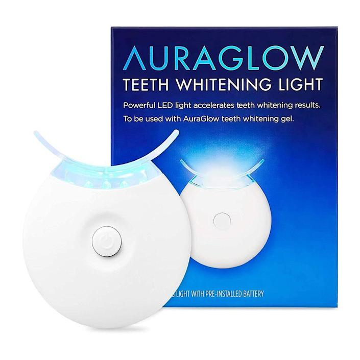 """<p><strong>AURAGLOW</strong></p><p>amazon.com</p><p><strong>$19.99</strong></p><p><a href=""""https://www.amazon.com/dp/B015TJ56EG?tag=syn-yahoo-20&ascsubtag=%5Bartid%7C2089.g.256%5Bsrc%7Cyahoo-us"""" rel=""""nofollow noopener"""" target=""""_blank"""" data-ylk=""""slk:Shop Now"""" class=""""link rapid-noclick-resp"""">Shop Now</a></p><p>Give the gift of a brighter smile with this teeth-whitening gadget. This LED light can be used with any whitening gels or strips to accelerate the process, creating a pearly, bright smile in half of the time that it would normally take.</p>"""