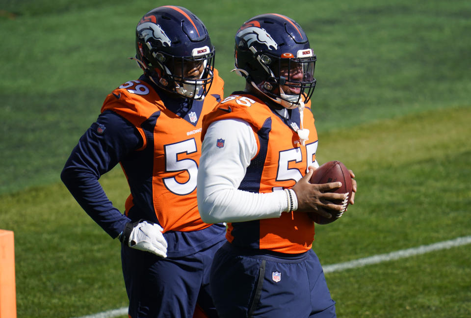 Denver Broncos outside linebacker Bradley Chubb, front, and linebacker Malik Reed take part in drills during an NFL football practice Wednesday, Oct. 14, 2020, at the team's headquarters in Englewood, Colo. (AP Photo/David Zalubowski)