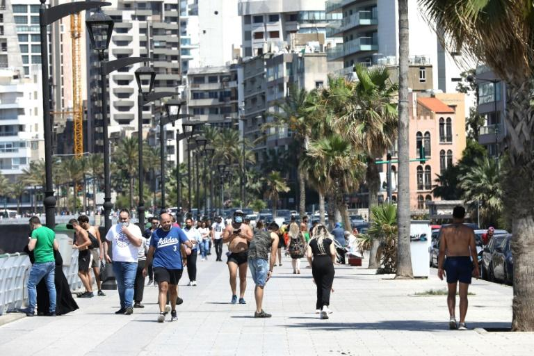 Residents of Beirut stroll along the seafront after an easing of restrictions to guard against the spread of coronavirus