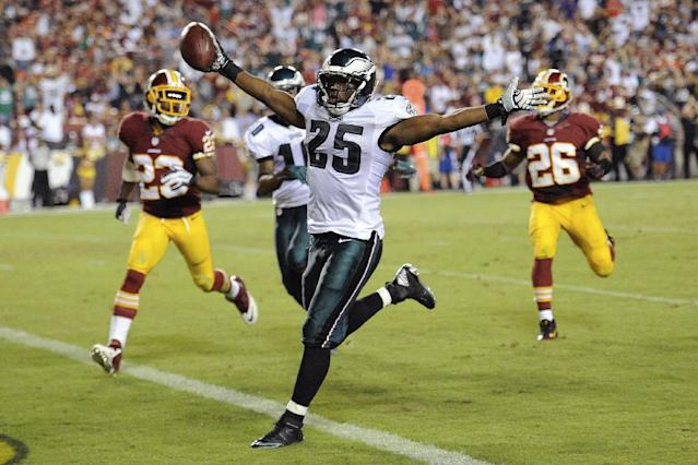 Philadelphia Eagles running back LeSean McCoy celebrates has he crosses the goal line for a touchdown during the second half of an NFL football game against the Washington Redskins in Landover, Md., Monday, Sept. 9, 2013. (AP Photo/Nick Wass)