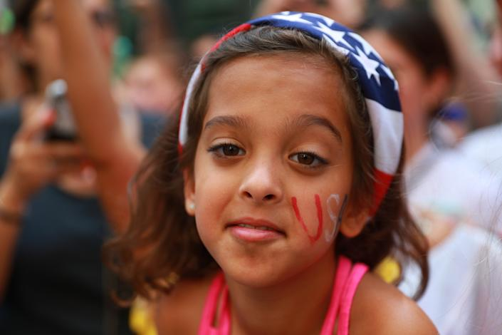 A fan has her face painted as she came out to celebrate the U.S. women's soccer team pass by during a ticker tape parade along the Canyon of Heroes, Wednesday, July 10, 2019, in New York. (Photo: Gordon Donovan/Yahoo News)