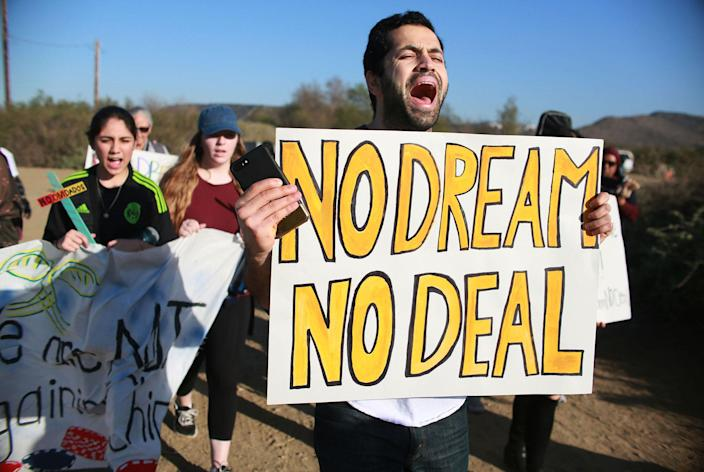 <p>Activists and immigrants chant during a rally along the U.S.-Mexico border in support of passage of the Dream Act, Feb. 7, 2018 in San Ysidro, Calif. (Photo: Sandy Huffaker/Getty Images) </p>