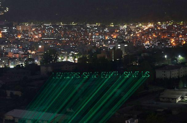 PHOTO: A laser beam show aimed at raising the awareness of climate change risks on the eve of the Leaders Summit on Climate, reads, 'Leaders Save Earth Save Us,' in Seoul, South Korea, April 21, 2021. (Ahn Young-joon/AP)