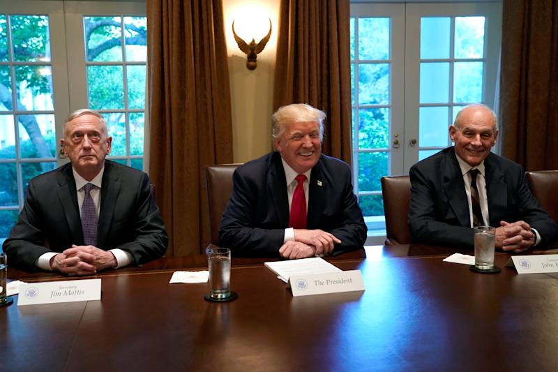 President Donald Trump, flanked at a White House meeting on Oct. 5, 2017, by Defense Secretary James Mattis and White House Chief of Staff John Kelly. (Yuri Gripas / Reuters)