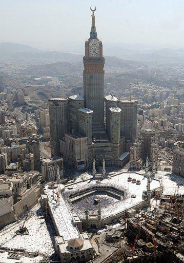 Aerial view of skyscraper which overlooks the Grand Mosque in the Saudi holy city of Mecca. Close to the Grand Mosque and the glitzy five-star hotels surrounding it lie slums whose mostly immigrant dwellers fear they will be evicted to make way for new high rises and malls