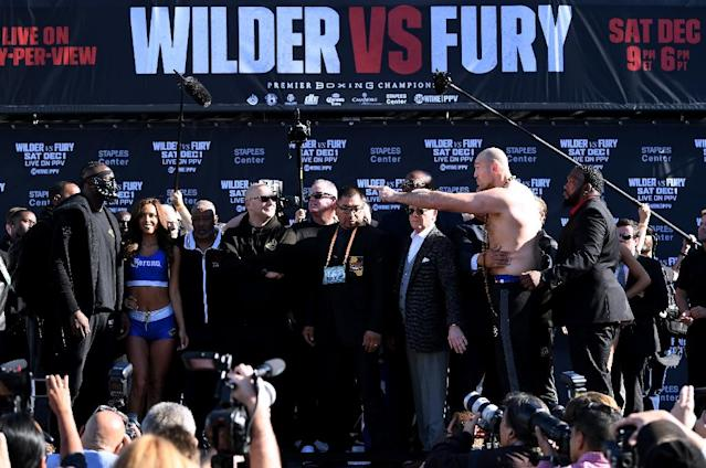 Tyson Fury taunts Deontay Wilder at the weigh-in for their WBC heavyweight world title fight (AFP Photo/Harry How)
