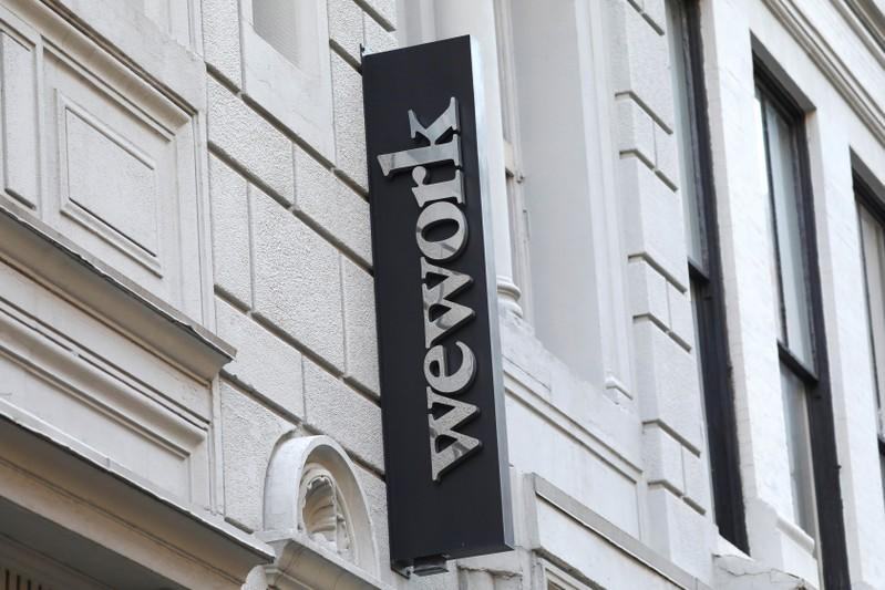 A sign is seen above the entrance to the WeWork corporate headquarters in Manhattan, New York