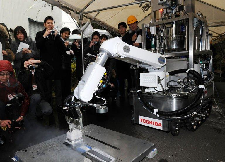 A Toshiba decontamination robot, for work inside a nuclear plant, is used during a demonstration at Toshiba's technical center in Yokohama, suburban Tokyo on February 15, 2013. The crawler robot blasts dry ice particles against contaminated floors or walls and will be used for the decontamination in TEPCO's stricken Fukushima nuclear power plant