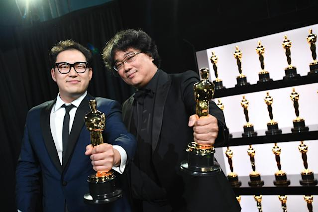 Best Original Screenplay award winners Han Jin Won and Bong Joon Ho pose backstage during the 92nd Annual Academy Awards at the Dolby Theatre on February 09, 2020 in Hollywood, California. (Photo by Richard Harbaugh - Handout/A.M.P.A.S. via Getty Images)
