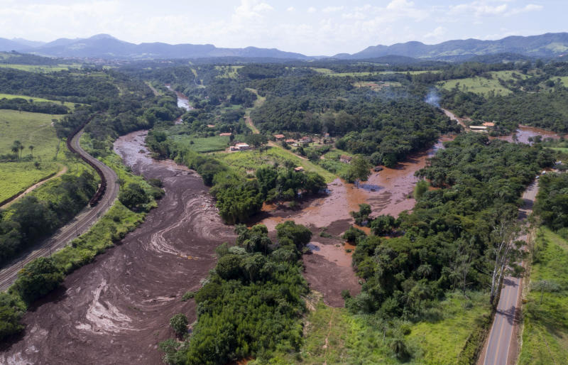 An aerial view shows flooding triggered by a dam collapse near Brumadinho Brazil Friday Jan. 25 2019. Brazilian mining company Vale SA said it didn't yet have information on deaths or injuries at the dam but said that tailings have reached the commu