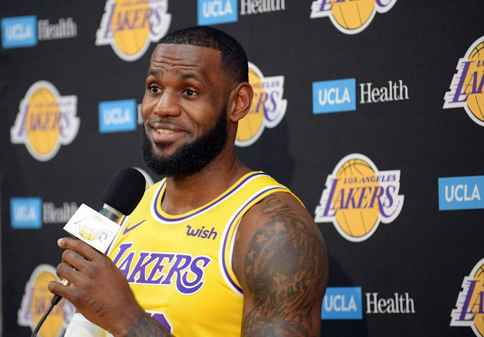 Los Angeles Lakers star LeBron James confirmed for the first time he is vaccinated against COVID-19. (Gary A. Vasquez/USA TODAY Sports)