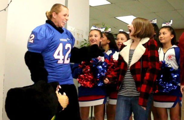 PHOTO: Sgt. Lacey Poltoratskiy removed her daughter's school mascot head to reveal herself. (Midway ISD)