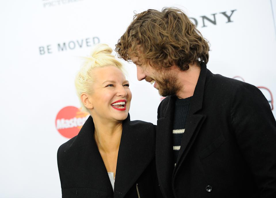 """Singer Sia Furler and fiance Erik Anders Lang attend the world premiere of """"Annie"""" at the Ziegfeld Theatre on Sunday, Dec. 7, 2014, in New York. (Photo by Evan Agostini/Invision/AP)"""