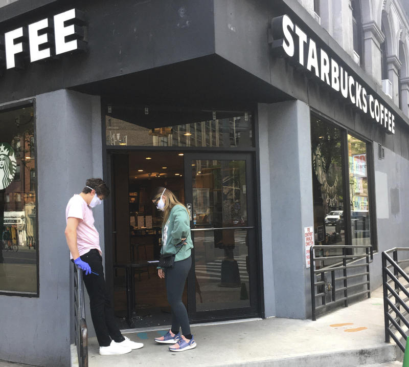 Photo by: STRF/STAR MAX/IPx 2020 5/15/20 2 patrons stand outside a Starbucks in Manhattan during the coronavirus pandemic in NYC.