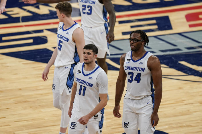 Creighton's Marcus Zegarowski (11), Denzel Mahoney (34) and Alex O'Connell (5) head to the bench during the second half of the team's NCAA college basketball game against Butler in the Big East men's tournament Thursday, March 11, 2021, in New York. (AP Photo/Frank Franklin II)