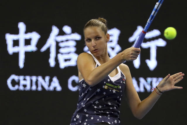 Karolina Pliskova of the Czech Republic hits a return shot while competing against Wang Qiang of China in their third round women's singles match in the China Open at the National Tennis Stadium in Beijing, Thursday, Oct. 4, 2018. (AP Photo/Mark Schiefelbein)