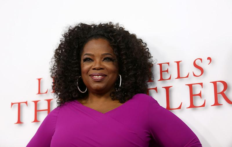"""FILE - In this Aug. 12, 2013 file photo, Oprah Winfrey arrives at the Los Angeles premiere of """"Lee Daniels' The Butler"""" at the Regal Cinemas L.A. Live Stadium 14, in Los Angeles. Winfrey is paying tribute to the late Nelson Mandela at the NAACP Image Awards on Saturday, Feb. 22, 2014. """"12 Years a Slave,"""" """"Lee Daniels' The Butler,"""" """"Fruitvale Station,"""" ''Mandela: Long Walk to Freedom"""" and """"The Best Man Holiday"""" are vying for the outstanding motion picture trophy. (Photo by Matt Sayles/Invision/AP, file)"""