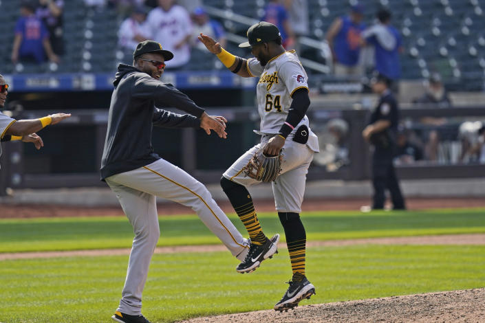 Pittsburgh Pirates' Rodolfo Castro, right, celebrates with teammates after a baseball game against the New York Mets at Citi Field, Sunday, July 11, 2021, in New York. The Pirates defeated the Mets 6-5.(AP Photo/Seth Wenig)
