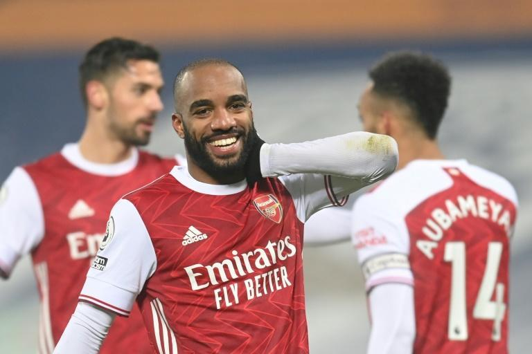 Smiling again: Alexandre Lacazette (centre)scored twice in Arsenal's 4-0 thrashing of West Brom