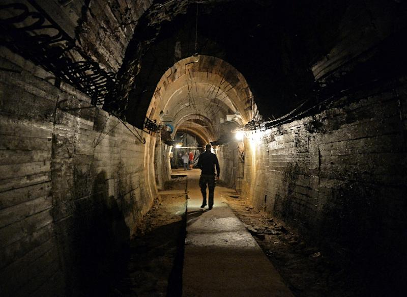 Men walk in underground galleries on August 28, 2015 under the Ksiaz castle in the area where a Nazi gold train is supposedly hidden in Walbrzych, Poland (AFP Photo/Janek Skarzynski)